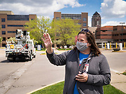 "06 MAY 2020 - DES MOINES, IOWA: A member of the nursing staff at Unity Point Health Iowa Methodist Medical Center in Des Moines, waves to passing police and fire vehicles as they drive past the hospital. Des Moines first responders, the Iowa State Patrol, and utility companies made an ""Appreciation Loop"" around the hospital on National Nurses' Day to thank nurses and other care givers at the hospital for the care they are providing during the COVID-19 (Coronavirus/SARS-CoV-2) pandemic. Iowa reported 10,404 confirmed cases of COVID-19 statewide Wednesday, about 2,500 cases in the Des Moines metropolitan area. Acting against the advice of many medical professionals, the Governor of Iowa has started reopening businesses in the state. Businesses in the Des Moines area, and other communities with a high number of cases are not allowed to reopen.     PHOTO BY JACK KURTZ"