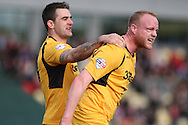 Newport's Lee Minshull (right) celebrates after scoring his side's first goal. Skybet football league 2 match, Newport county v Scunthorpe Utd at Rodney Parade in Newport, South Wales on Saturday 1st March 2014.<br /> pic by Mark Hawkins, Andrew Orchard sports photography.