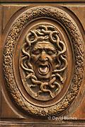 France, Paris, Marais, Face carved on door. Medusa