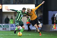 Dannie Bulman of AFC Wimbledon and Olliver McBurnie  of Newport County tussle during the Sky Bet League 2 match between Newport County and AFC Wimbledon at Rodney Parade, Newport, Wales on 19 December 2015. Photo by Stuart Butcher.