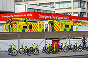 April 7, 2020, London, England, United Kingdom: NHS Emergency Ambulances are seen outside St Thomas' Hospital in central London as British Prime Minister Boris Johnson is in intensive care fighting the coronavirus in London, Tuesday, April 7, 2020. (Credit Image: © Vedat Xhymshiti/ZUMA Wire)