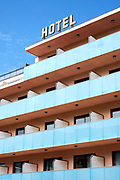 A hotel with balconies and a blus sky in Spain