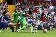 Aston Villa 's Carles Gil (25) is fouled in the penalty area by Younes Kaboul of Sunderland (15) but no penalty is given and Carles Gil is booked by referee Robert Madley for diving.Barclays Premier League match, Aston Villa v Sunderland at Villa Park in Birmingham, Midlands on Saturday 29th August  2015.<br /> pic by Andrew Orchard, Andrew Orchard sports photography.