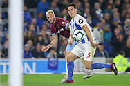 West Ham United forward Marko Arnautovic (7) crosses from Brighton and Hove Albion defender Lewis Dunk (5) during the Premier League match between Brighton and Hove Albion and West Ham United at the American Express Community Stadium, Brighton and Hove, England on 5 October 2018.