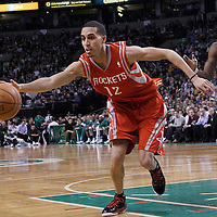 06 March 2012: Houston Rockets shooting guard Kevin Martin (12) stretches for the ball during the Boston Celtics 97-92 (OT) victory over the Houston Rockets at the TD Garden, Boston, Massachusetts, USA.