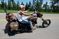 Betsy Huelskamp riding her rusty chopper on the Cycle Source Ride up Vanocker Canyon to Nemo during the Sturgis Black Hills Motorcycle Rally. SD, USA. Wednesday, August 7, 2019. Photography ©2019 Michael Lichter.