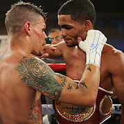 Challenger Orlando Cruz (white trunks) congratulates winner Gamalier Rodriguez (blue/black trunks) after he retains the NABO Featherweight Title at the Bahia Shriners Center on Saturday, April 19, 2014 in Orlando, Florida.  (AP Photo/Alex Menendez)