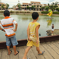 Boys playing by the canals of Hoi An