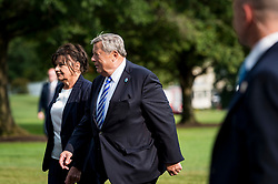 Viktor and Amalija Knavs, parents of First Lady Melania Trump, walk toward the White House after disembarking from Marine One with President Donald Trump, the First Lady and their son Barron, after returning to the White House on Aug. 19, 2018 in Washington, D.C. President Trump was returning from the weekend at his Bedminster, New Jersey golf resort. Photo by Pete Marovich/AbacaPress/Pool