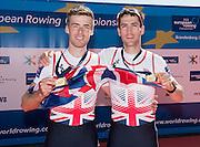 Brandenburg. GERMANY. GBR LM2-. left, Joel CASSELLS and Sam SCRIMGEOUR, Gold Medalist.<br /> 2016 European Rowing Championships at the Regattastrecke Beetzsee<br /> <br /> Sunday  08/05/2016<br /> <br /> [Mandatory Credit; Peter SPURRIER/Intersport-images]