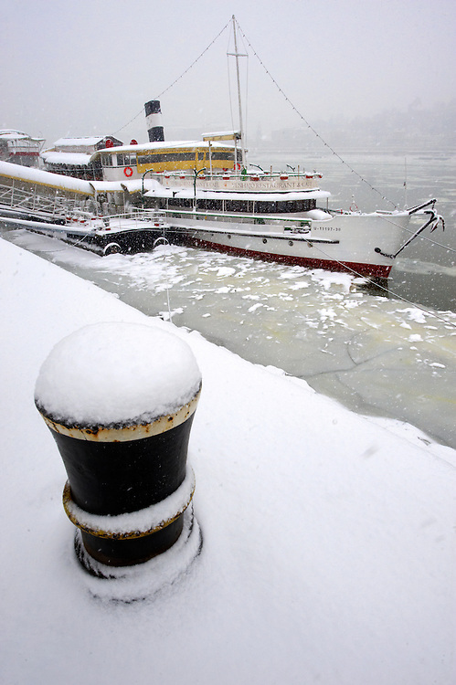 Kosuth boat in theice on the frozen Danube and winter snow. Budapest winter photos .<br /> <br /> Visit our HUNGARY HISTORIC PLACES PHOTO COLLECTIONS for more photos to download or buy as wall art prints https://funkystock.photoshelter.com/gallery-collection/Pictures-Images-of-Hungary-Photos-of-Hungarian-Historic-Landmark-Sites/C0000Te8AnPgxjRg