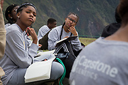 Kalaezia Collins, 13, left and Alexia Smith, 13, think deeply as they write in their journals. The kids are required to write everyday about what they have learned and experienced on the adventure.