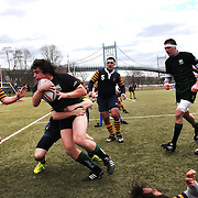 Action during the Hofstra V Loyola (green) rugby match during the Four Leaf 15's Club Rugby Tournament at Randall's Island New York. The tournament included 70 teams in 6 divisions, organized by the New York City Village Lions RFC. Randall's Island, New York, USA. 23rd March. Photo Tim Clayton