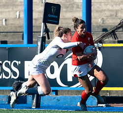 Jess Kavanagh of Wales is tackled by Abby Dow of England<br /> <br /> Photographer Simon King/Replay Images<br /> <br /> Six Nations Round 3 - Wales Women v England Women - Sunday 24th February 2019 - Cardiff Arms Park - Cardiff<br /> <br /> World Copyright © Replay Images . All rights reserved. info@replayimages.co.uk - http://replayimages.co.uk
