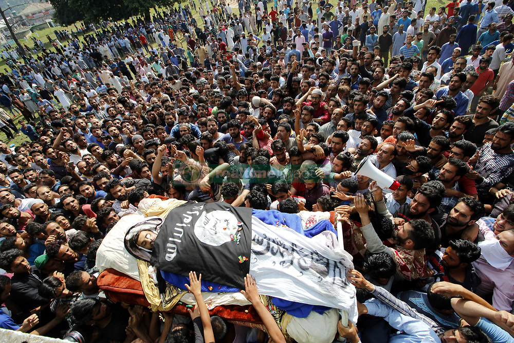 August 4, 2017 - Anantnag, Jammu and Kashmir, India - People carry body of of a slain Kashmiri Hizb Rebel Yawar Ahmad Alias Gazi funeral procession in Janglatandi locality of old town Anantnag, 55 KMs South  of Srinagar. Yawar a 17 day old rebel was killed in an encounter with security forces in Kanelwan village in Dochnipora belt of Bijbehara in the same district on Thursday night. (Credit Image: © Muneeb Ul Islam/Pacific Press via ZUMA Wire)