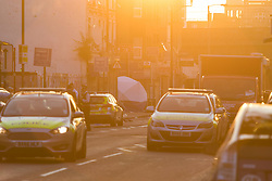 """Finsbury Park, London, June 19th 2017. A major police and emergency services operation with firearms officers in attendance is underway near Finsbury Park Mosque following reports of Several people being injured after a van struck a crowd of pedestrians near a north London mosque in what police have called a """"major incident"""". PICTURED: The sun rises as a police tent is seen at the location of the incident."""