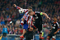 Atletico de Madrid´s Gimenez and Bayer 04 Leverkusen´s Bender during the UEFA Champions League round of 16 second leg match between Atletico de Madrid and Bayer 04 Leverkusen at Vicente Calderon stadium in Madrid, Spain. March 17, 2015. (ALTERPHOTOS/Victor Blanco)