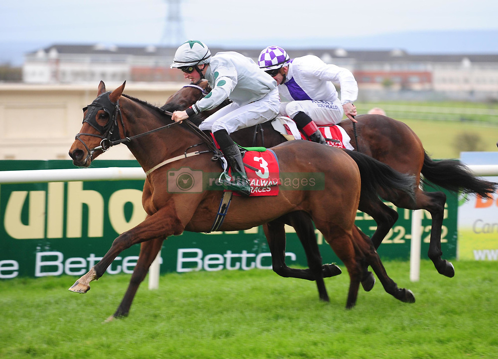 Canary Row and Ross Coakley on their way to winning the Kone Handicap from Vocal Music ridden by Kevin Manning (left). during day three of the October Festival at Galway Racecourse.
