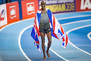 Mo Farah (GBR) of Great Britain after winning the men's 5000 meters final and his last indoors track race dropped in the Union Jack during the Muller Indoor Grand Prix at the Barclaycard Arena, Birmingham, United Kingdom on 18 February 2017. Photo by Martin Cole.