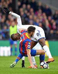 Crystal Palace's Yohan Cabaye (floor) and Leicester City's Kelechi Iheanacho battle for the ball during the Premier League match at Selhurst Park, London.