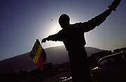 A boy, silhouetted against the sun, tries to fly his kite in the city of Mazar-i-Sharif, Afghanistan. Kite flying is a national pastime for the Afghans but was banned during the rule of the Taliban