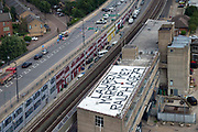 A marriage proposal painted onto the roof of  a building seen from the Emirates cable car in Greenwich ,London, United Kingdom on 9th August 2019.