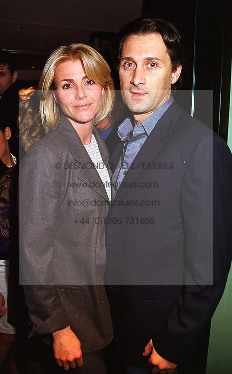 MRS NINA JUNOT and her close friend MR RAFFAELE MINCIONE,  at a party in London on 21st April 1999.MRG 66