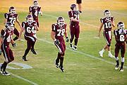23 SEPTEMBER 2011 - SCOTTSDALE, AZ: Desert Mountain players warm up before the game at Desert Mountain High School in Scottsdale. Desert Mountain played Notre Dame in Desert Mountain's homecoming high school football game.     PHOTO BY JACK KURTZ