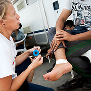 MSF nurse Ida Tornstensson is giving first aid outside the mobile camper van of MSF at Mytiline port, Lesvos, Greece.