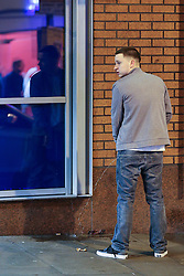 © Licensed to London News Pictures . 01/01/2014 . Manchester , UK . A man urinates against a wall on Withy Grove in Central Manchester . Revellers see in the New Year in Manchester today (January 1st 2014) as police report that officers are at full stretch responding to calls . Photo credit : Joel Goodman/LNP