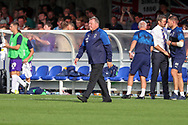 AFC Wimbledon manager Wally Downes walking off pitch after final whistle during the EFL Sky Bet League 1 match between AFC Wimbledon and Shrewsbury Town at the Cherry Red Records Stadium, Kingston, England on 14 September 2019.