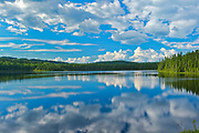 CLouds reflected in La Rivière Saint-Maurice<br />Grande Anse<br />Quebec<br />Canada