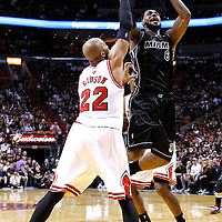 29 January 2012: Miami Heat small forward LeBron James (6) takes a jumpshot over Chicago Bulls forward Taj Gibson (22) during the Miami Heat 97-93 victory over the Chicago Bulls at the AmericanAirlines Arena, Miami, Florida, USA.