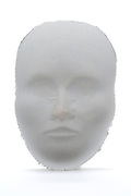 a ghostly impression of a human face