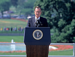 United States President George H. W. Bush makes remarks prior to signing the Americans with Disabilities Act of 1990 into law during a ceremony on the South Lawn of the White House in Washington, D.C. on July 26, 1990. The act prohibited employer discrimination on the basis of disability. Credit: Ron Sachs / CNP /ABACAPRESS.COM