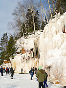 People gather to marvel at the Apostle Island Ice Caves, Makwike Bay, near Bayfield, Wisconsin, on a cold February day.