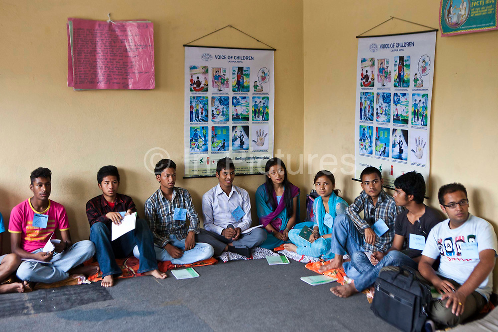 Nepalese teenagers sit and listen during a life skills training session in Bisaneu Voice of Children centre in Kathmandu, Nepal.  The session is part of the rehabilitation program run by Voice of Children.  The not-for-profit organisation supports street children and those who are at risk of sexual abuse through educational and vocational training opportunities, health services and psychosocial counseling.