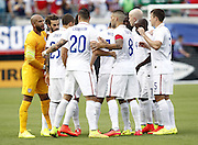 JACKSONVILLE, FL - JUNE 07:  The starting lineup of the United States talks before the international friendly match against Nigeria at EverBank Field on June 7, 2014 in Jacksonville, Florida.  (Photo by Mike Zarrilli/Getty Images)
