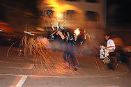 """Bolivia. Tarija. Festa di San Roque..If the day is dedicated to the procession, the evening is feast and among other shows there is also a bullfight """"pyrotechnics"""" in memory of an authentic, which was held during the San Roque at the beginning of the last century."""