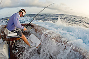 Big game fishing anglers in a variety of sport fishing boats.  These anglers can be seen using many different types of fishing tackle and rods and reels.