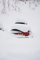 The Wasatch Montains deliver the goods. Car in parking lot at Alta Ski Area, Utah.