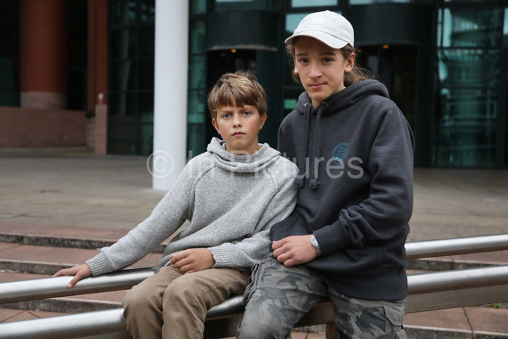 "Marley Luterbacher, 10 and Jolyon, 14 both students of Richard Loizou outside court after they have learned the verdict, September 26 20018, Preston, United Kingdom. Richard is their teacher and they drove through the night from Devon to show their support. Simon Roscoe Blevins, 26,  Richard Roberts, 36 were both sentenced 16 months in prison, Richard Loizou, 31, sentenced 15 months in prison and  and Julian Brock, 47 12 months supended. Simon Roscoe Blevins, 26,  Richard Loizou, 31, Richard Roberts, 36 and Julian Brock, 47 climbed on top of several trucks during a mass protest by locals and supporters in New Preston Road, against fracking in Lancashire, July 2017. The trucks were prevented form delivering equipment to Cuadrillas nearby fracking site for four days. After a seven day jury trial at Preston Crown Court in August 2018, the four men were found guilty of Public Nuisance. Judge Altham has told them to expect ""immediate custodial sentences"" on 25th September 2018."