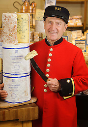 "© Licensed to London News Pictures. 17/12/2013 London, UK. Chelsea Pensioner Jimmy Anderson celebrates the 100th anniversary of Colston Bassett Stilton at Whole Foods Market, Kensington, London. The world renowned cheese has been made in the same Nottinghamshire factory  since 1913 where only 4 head cheese makers have overseen the process. The cheese won  ""Best British Cheese' at this years World Cheese Awards.<br /> Photo credit : Simon Jacobs/LNP"