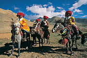 Horsemen ride to festival, Southern Tibet