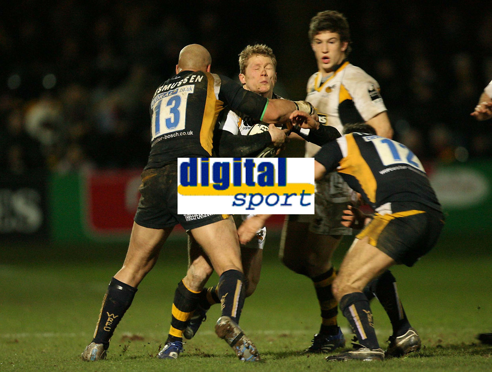Photo: Rich Eaton.<br /> <br /> Worcester Rugby v London Wasps. Guinness Premiership. 26/01/2007. Josh Lewsey of Wasps centre on the receiving end of a big tackle from Worcesters Dale Rasmussen left and Gary Trueman right