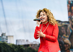 © Licensed to London News Pictures. 07/06/2013. London, UK.   Ella Eyre of Rudimental performing live at Finsbury Park, supporting headliner The Stone Roses .   Rudimental are an English electronic music quartet consisting of songwriters and producers Piers Agget, Kesi Dryden, Amir Amor and DJ Locksmith and vocalist Ella Eyre.  Photo credit : Richard Isaac/LNP
