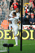 Swansea city's Luke Moore (19) celebrates with Wayne Routledge after he scores the first goal to make it 1-0.   Barclays premier league, Swansea city v Newcastle Utd at  the Liberty stadium in Swansea, South Wales on Saturday 2nd March 2013. pic by  Andrew Orchard, Andrew Orchard sports photography,