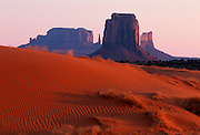 ARIZONA, MONUMENT VALLEY TRIBAL PARK on Navajo Reservation, spectacular sandstone buttes rise above sand dunes