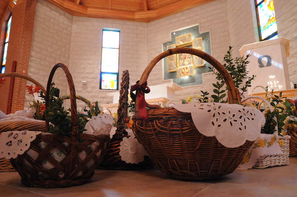 Baskets are ready for blessing by Francis Cardinal George during a Holy Saturday Blessing of Easter Baskets at Our Lady, Mother of the Church Polish Mission in Willow Springs.