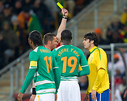 Referee Stephane Lannoy with yellow card for Kaka of Brazil during the 2010 FIFA World Cup South Africa Group G Second Round match between Brazil and République de Côte d'Ivoire on June 20, 2010 at Soccer City Stadium in Soweto, suburban Johannesburg, South Africa.  Brazil defeated Ivory Coast 3-1. (Photo by Vid Ponikvar / Sportida)